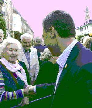 Politiker skakar hand med väljare, färgreducerad bild